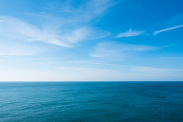 cloudy blue sky leaving for horizon above a blue surface of the sea Fotomurales