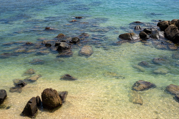 Sparkling water of the Indian Ocean in Sri Lanka near Galle. Rocks in the water