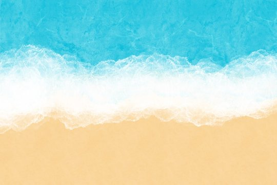 Turquoise ocean water with sea foam and yellow sand, top view