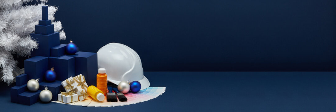 Construction hard hat, colour guide, Christmas decorations. Christmas and New Year construction. Extra wide banner background