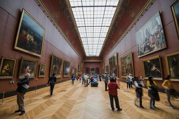PARIS, FRANCE - MAY 6, 2017: People visiting Louvre Museum, Paris.
