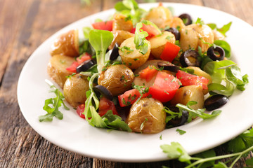 Wall Mural - roasted potato salad with tomato, olive and lettuce