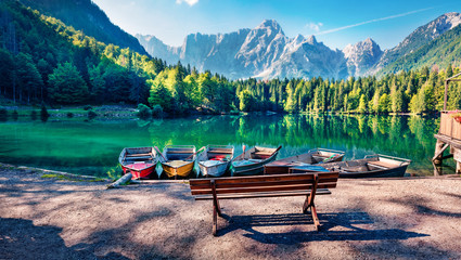 Six pleasure boats on Fusine lake. Spectacular morning scene of Julian Alps with Mangart peak on background, Province of Udine, Italy, Europe. Traveling concept background. Fotomurales