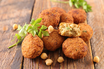 fried falafel with herb on wood background