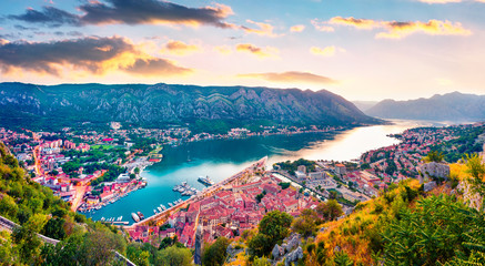 By the Old Town way to Saint John chapel there is a magnificent panorama of Kotor Bay and the city of the same name - Kotor, Montenegro. Fantastic summer sunset in Kotor port. Fotomurales