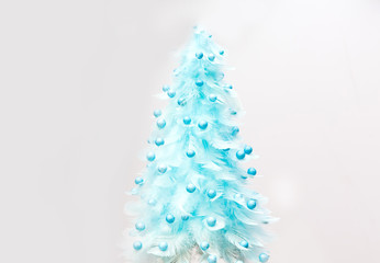 Photo Stands Roe Christmas tree made of feathers on a white background