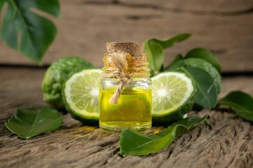 fresh bergamot fruit, Kaffir Lime, Citrus bergamia with leaf on wooden table. Bergamot citrus fruit essential oil or virgin cold pressed oil natural.organic cosmetic concept