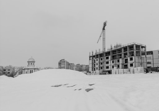 Building under construction with snow in winter