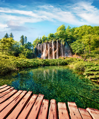 Self adhesive Wall Murals Waterfalls Spectacular summer scene of green forest with pure water waterfall in Plitvice Lakes National Park. Colorful countryside landscape of Croatia, Europe. Traveling concept background.