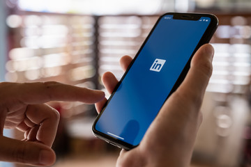 CHIANG MAI, THAILAND: May 06, 2019: LinkedIn logo on phone screen. LinkedIn is a social network for search and establishment of business contacts. It is founded in 2002.