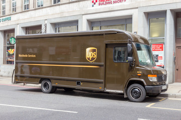 LONDON - JULY 2, 2015: UPS truck in a street in London. UPS is one of largest package delivery companies worldwide with 397,100 employees and USD 54.1 billion revenue (2012).