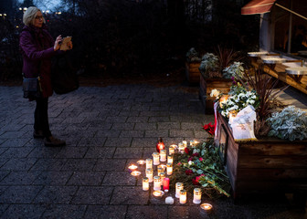 A fan takes pictures at a makeshift memorial for Swedish pop singer and songwriter Marie Fredriksson outside Baggpipe Studios in Skarmabrink, Stockholm
