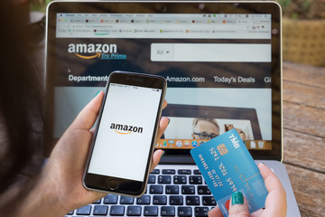 CHIANG MAI,THAILAND - OCT 01, 2017 : iPhone 6s showing Amazon logo and credit card shopping online. Amazon.com, Inc. American international electronic commerce company.