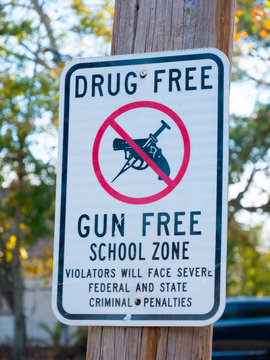 Drug Free and Gun Free School Zone sign in New Orleans, Louisiana, USA.