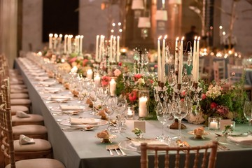 Beautiful wedding table setting with floral decorations and candles