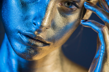 Close-up silver portrait of a woman with glitter make-up Wall mural