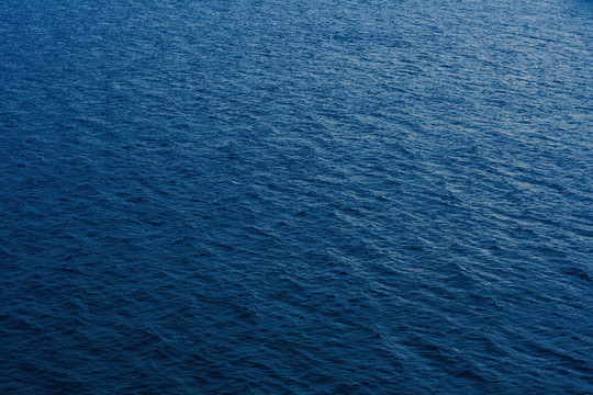Abstract calm sea or ocean water surface background. 2020 color trend