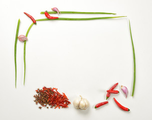Vegetable picture frame made with onion, garlic, red chili pepper, chive and garlic.