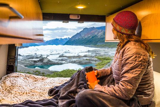 A woman relaxes in a van near the Matanuska Glacier, Alaska