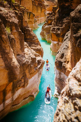 Man and woman standup paddleboarding in Havasu Creek