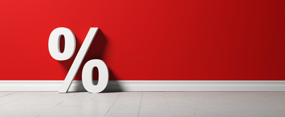 a percent sign in front of a red wall