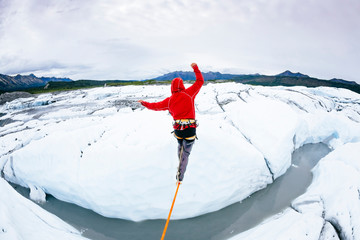 Rear view of man slacklining at Matanuska Glacier