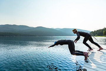 Man and woman diving in Whitefish Lake