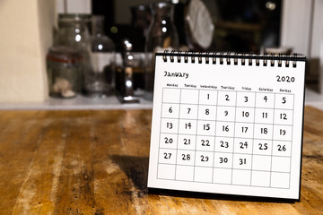 January 2020 calendar - month page on wooden table in the kitchen