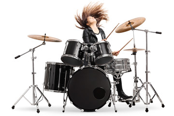 Energetic female drummer throwing her hair and playing drums Fotobehang