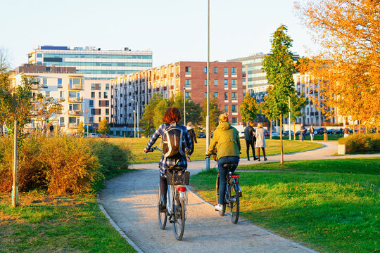 Girls on bicycles in public park in Vilnius