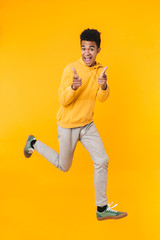 Full length portrait of an excited young african teenager boy