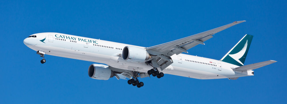 Chicago, USA - October 31, 2019: Cathay Pacific Airlines Boeing 777-300 aircraft on final approach at O'Hare International Airport. Cathay Pacific Airlines Limited is the flag carrier of Hong Kong.