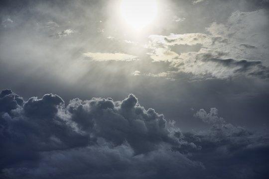 Beautiful scenery of white puffy clouds under bright sun rays