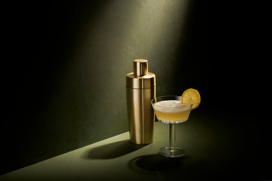 Sexy Dramatic Cocktail Mixed Drink Still Life on Olive Green Slate Background