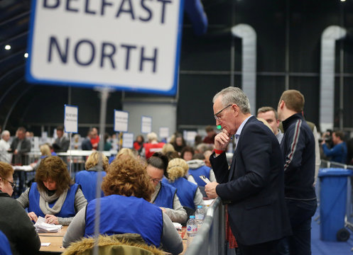 Sinn Fein's Gerry Kelly watches as the first ballot boxes are opened and the count begins at the count centre, Titanic Quarter, Belfast, Belfast, Northern Ireland