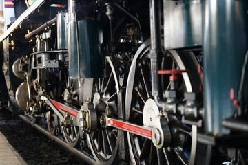 Bangkok,Thailand-December 5, 2019: Driving wheels and coupling rods on a steam locomotive made in Japan