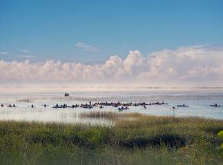 Large group of people kayaking