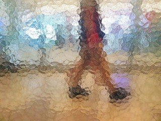 Person behind glass.Shadow abstract background.Rough surface and not clear.Textured design on mirror glass