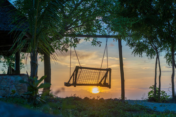 Wooden swing of beautiful sunset on the island of Zanzibar, Tanzania, East Africa