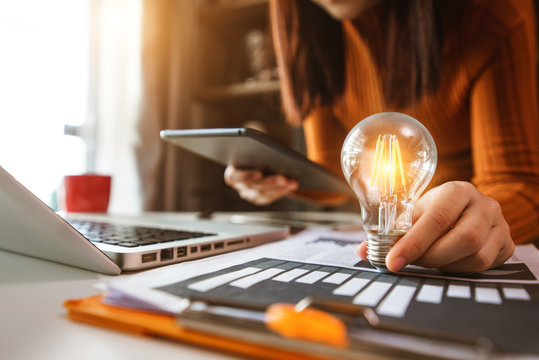business man using smartphone, tablet and holding light bulb, with idea with innovation and creativity