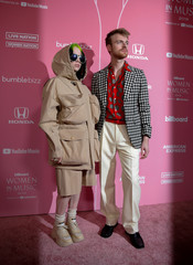 "Billie Eilish and her brother Finneas O'Connell arrive on the red carpet for the  ""Billboard Women in Music"" event in Los Angeles"
