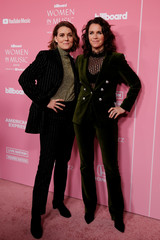 "Brandi Carlile and Catherine Shepherd arrive on the red carpet for the ""Billboard Women in Music"" event in Los Angeles,"