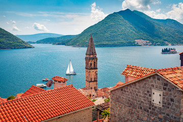 Foto auf Leinwand Blau Not far from the famous city of Kotor is a small town of Perast. Splendid morning scene of Kotor Bay, Montenegro, Europe. Traveling concept background. Beautiful world of Mediterranean countries.