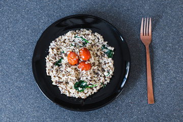 vegan coconut rice with spinach and cherry tomatoes