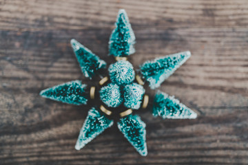 festive season's decorations group of miniature Christmas trees placed in shape of star