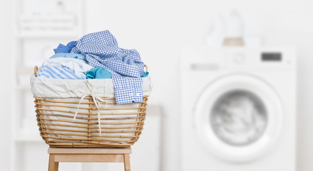 Laundry basket on blurred background of modern washing machine
