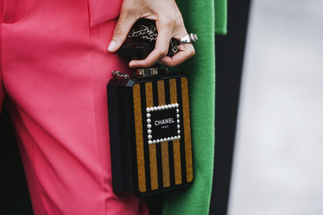 Paris, France - March 5, 2019: Street style - Chanel purse and outfit after a fashion show during Paris Fashion Week - PFWFW19
