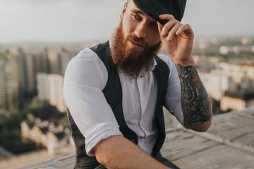 Stylish hipster adjusting vintage cap