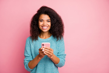 Photo of cheerful toothy beaming cute nice pretty woman holding telephone browsing social media...