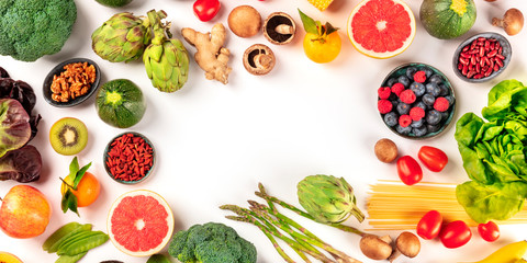 Vegan food panorama with copy space. Healthy diet concept. Fruits, vegetables, pasta, nuts,...